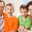 Stock Photo: Happy parents with children together