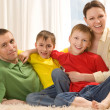 Stock Photo: Happy parents and children lie