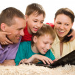 Stock Photo: Beautiful familywith a laptop
