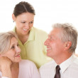 Elderly couple with daughter — Stock Photo #5440298