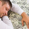 Sleeping man and money on white — Stock Photo