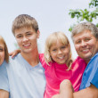 Happy children with parent — Stock Photo