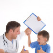 Stock Photo: Boy in doctors office