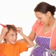 Beautiful mother and son prepares — Stock Photo #5441340