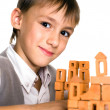 Handsome boy builds a toy castle — Stock Photo #5441367