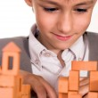 Handsome boy builds a toy castle — Stock Photo #5441371