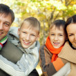 Portrait of a happy family of four — Stockfoto