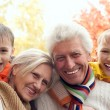 Family of four in a park — Stock Photo