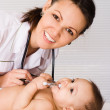 Beautiful doctor and baby — Stock Photo #5441847