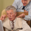 Two businessman working together at the computer — Stock Photo
