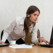 Young businesswoman in the office with two laptops — Stock Photo