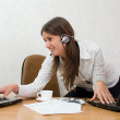 Young businesswoman at the desk with two laptops — Stock Photo