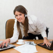 Quick smart girl at office desk with laptops — Foto de stock #5441988