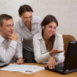 Stock Photo: Group of employees in the office with laptops