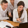 Office team of young with a laptop — Stock Photo