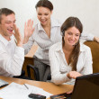 Stock Photo: Young businesspeople with the gestures of satisfaction