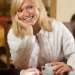 Royalty-Free Stock Photo: A blond in a cafe at tea