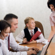 Young boy as a boss in the office with employees — Stock Photo #5442066