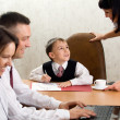 Cute kid in the role of an office manager — Stock Photo