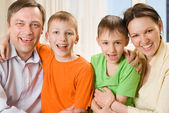 Happy parents with children together — Stock Photo