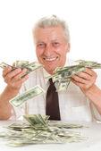 Elderly man holding money — Stock Photo