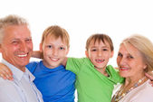 Elderly with their grandchildren — Stock Photo