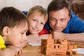 Father with children playing — Stock Photo