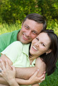 Couple in the summer park — Stock Photo