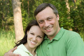 Happy couple in a park — Stock Photo