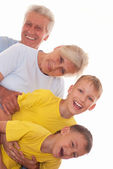 Smiling grandparents with grandsons — Stock Photo