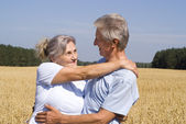 Old smiling couple — Stock Photo
