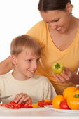 Mother and son prepares breakfast — Stock Photo