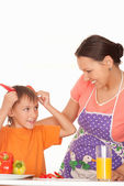 Beautiful mother and son prepares — Stock Photo