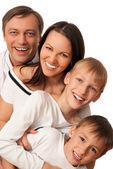 Miła rodzina czterech na światło — Zdjęcie stockowe
