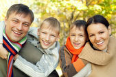 Portrait of a happy family of four — Stock Photo