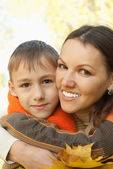 Mother and son walking — Stock Photo
