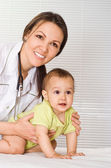 Beautiful doctor with baby — Stock Photo