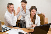 Young businesspeople with the gestures of satisfaction — Stock Photo