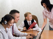 Young boy as a boss in the office with employees — Stock Photo