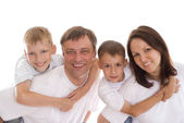 Portrait of happy famaly on a white — Stock Photo