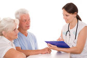Young doctor testing old couple.JPG — Stock Photo