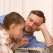 Father and son l with laptop — Stock Photo #5508977