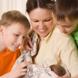 Young mother with three children — Stock Photo