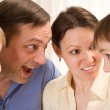 Family standing and surprise talks — Stock Photo