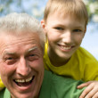Grandpa keeps his grandson — Stock Photo
