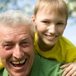 Stock Photo: Grandpkeeps his grandson