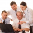 Four businessmen working — Stock Photo