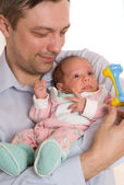 Father holding his hands on newborn — Stock Photo