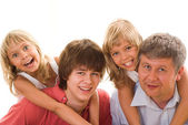 Happy family four — Stock Photo
