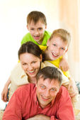 Happy family playing — Stock Photo